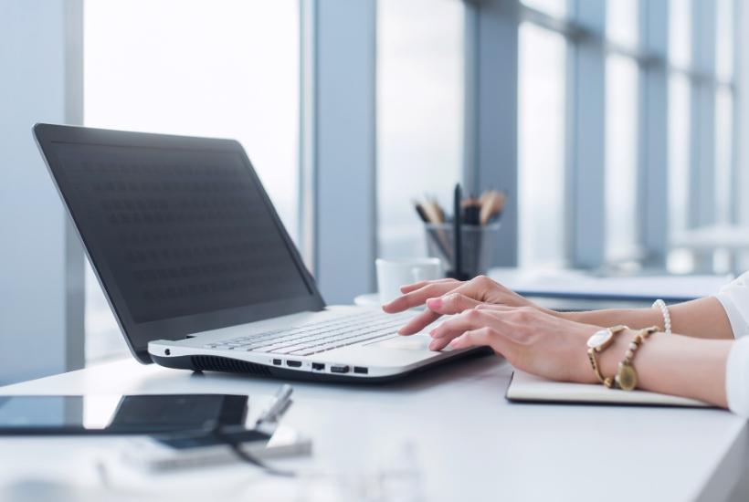 laptop open on desktop