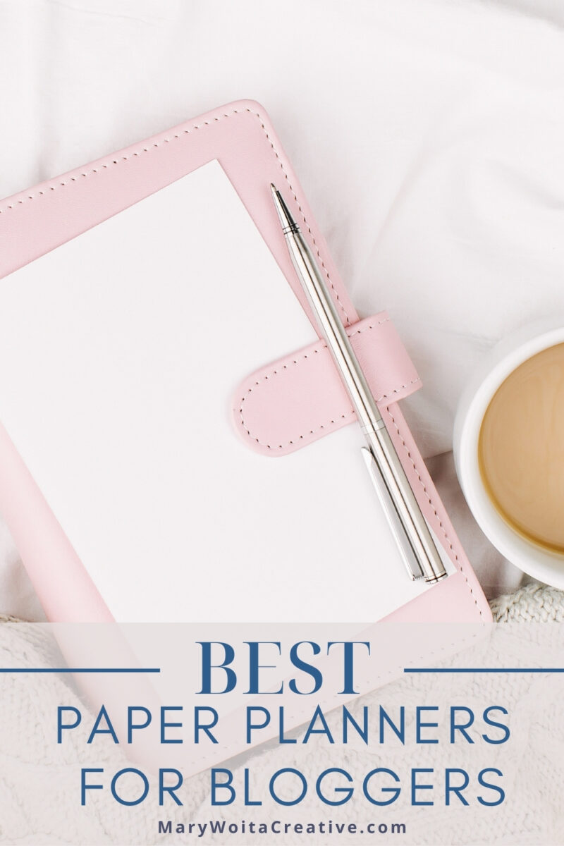 light pink planner with a cup of coffee