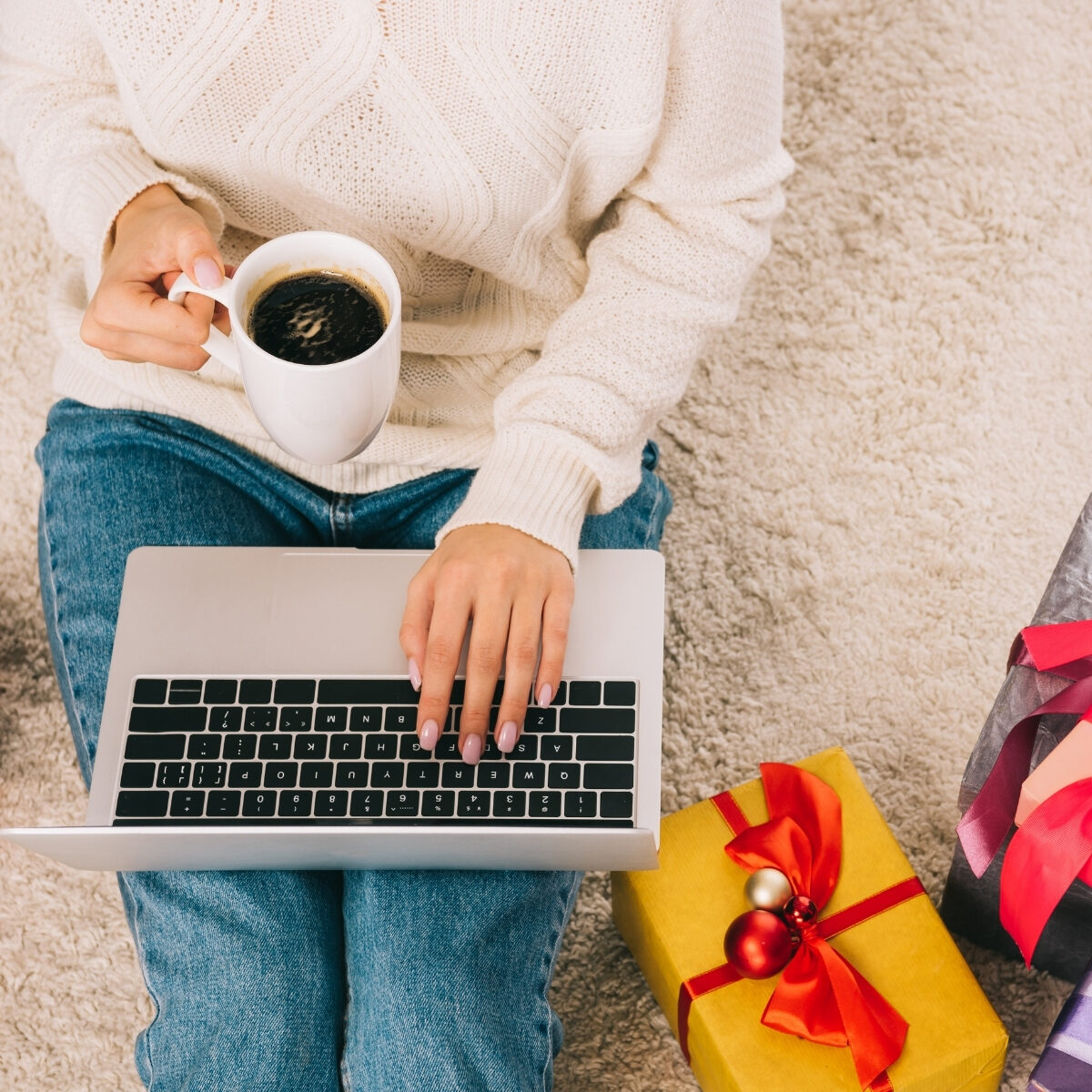 lady with laptop, cup of coffee and christmas gifts