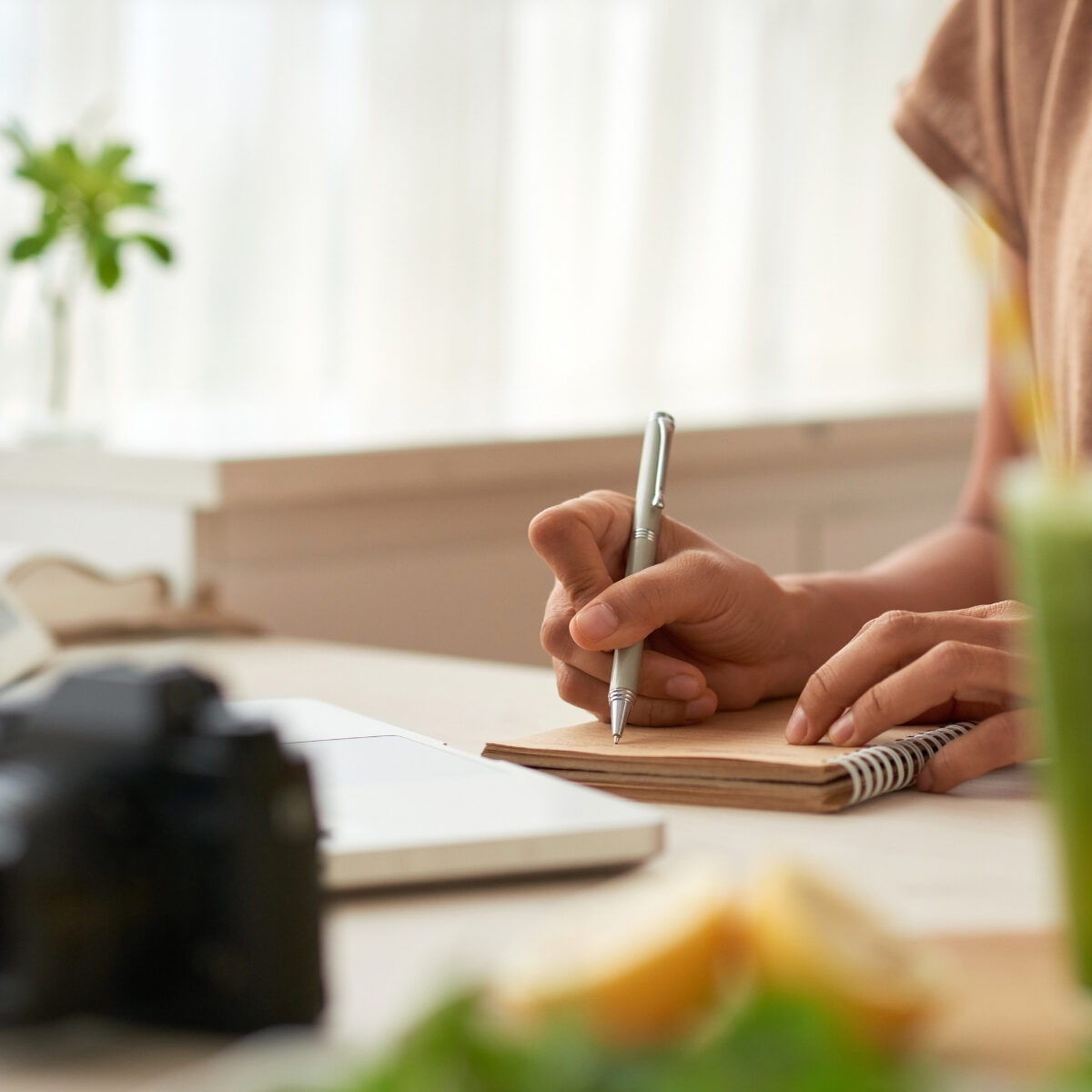 lady writing goals and tracking progress on notebook